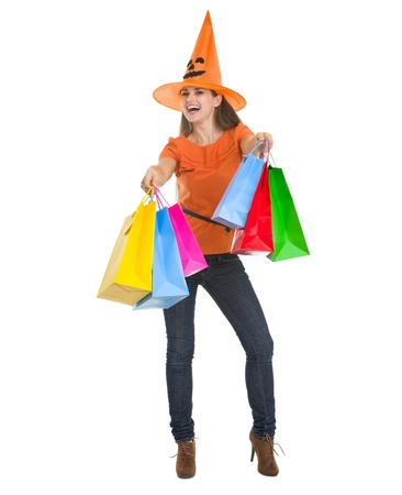Smiling woman in Halloween hat with shopping bags Stock Photo - 15786907