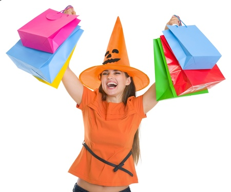 Smiling woman in Halloween hat rising up shopping bags Stock Photo - 15786918