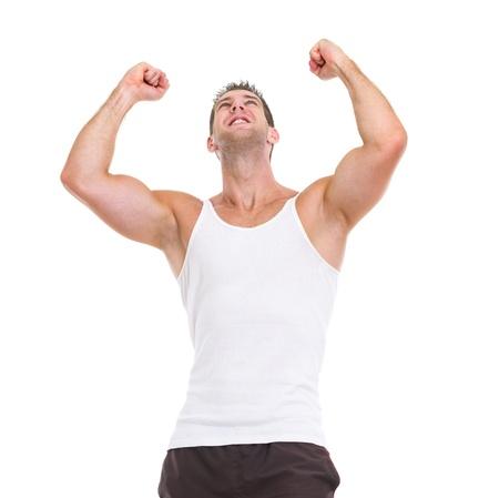exult: Happy male athlete rejoicing success Stock Photo