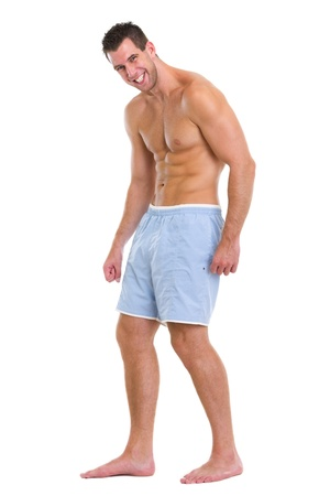 pectoral muscle: Full length portrait of muscular sports man