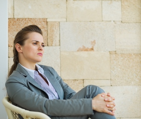 certitude: Portrait of confident business woman looking on copy space