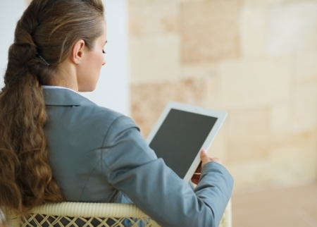 Business woman holding tablet PC. Rear view Stock Photo - 15885301