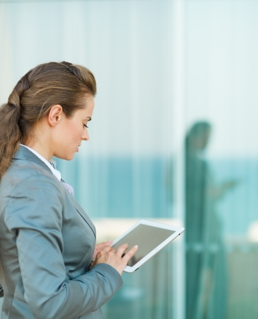 Business woman looking in tablet PC photo
