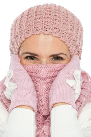 Woman in knit winter clothing closing face with scarf Stock Photo - 15892885