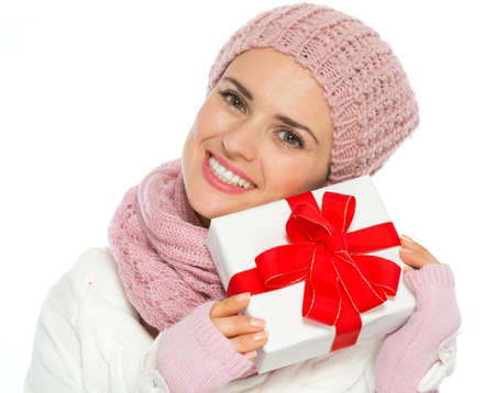 Happy woman in knit winter clothing holding Christmas present box Stock Photo - 15892908