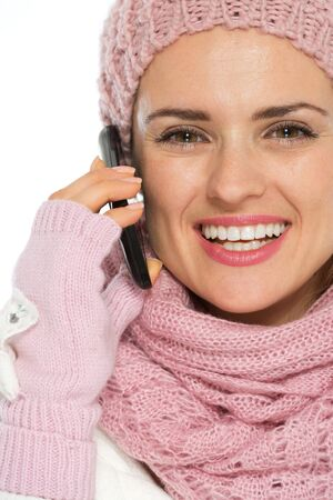 Smiling woman in knit winter clothing speaking mobile photo