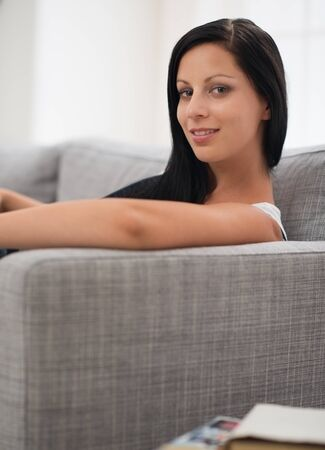 Happy girl laying on couch Stock Photo - 16084816