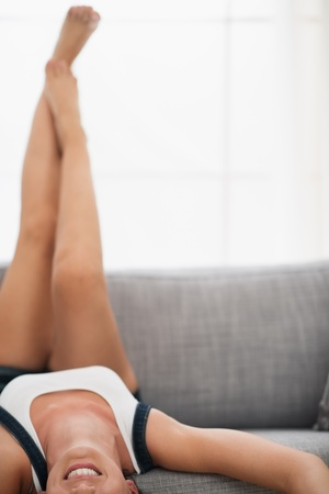 Closeup on young woman laying o sofa upside down Stock Photo - 16084782