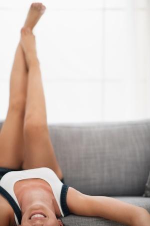 Closeup on young woman laying o sofa upside down Stock Photo - 16084782