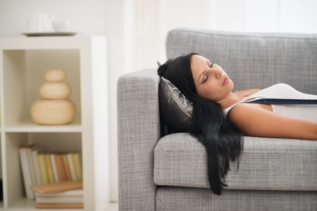 Young woman sleeping on sofa Stock Photo - 16084844