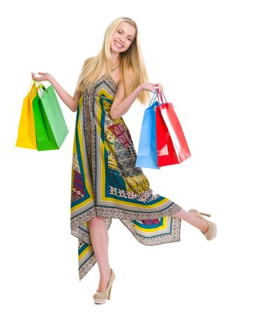 Happy girl in dress holding shopping bags Stock Photo - 16305068
