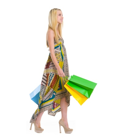 Happy girl in dress walking with shopping bags Stock Photo - 16305064