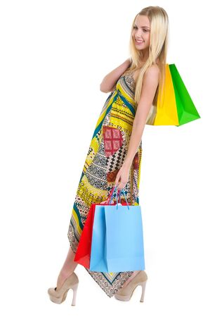 Happy girl in dress holding shopping bags Stock Photo - 16305073