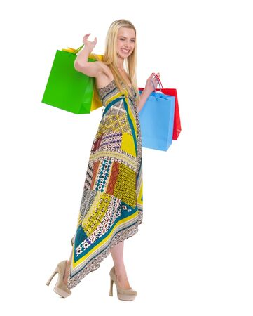 Smiling girl in dress with shopping bags photo