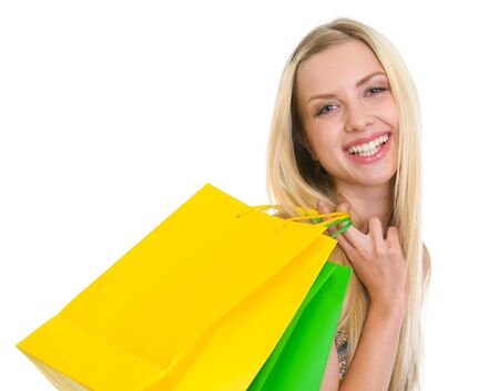 Portrait of smiling teenage girl with shopping bags Stock Photo - 16305065