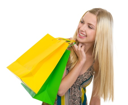 Smiling teenage girl with shopping bags looking on copy space Stock Photo - 16305066