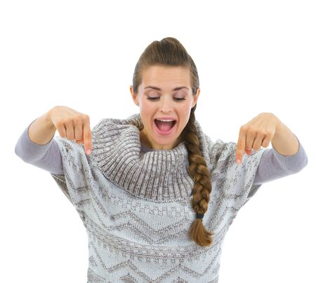Happy woman in sweater pointing down Stock Photo - 16336957