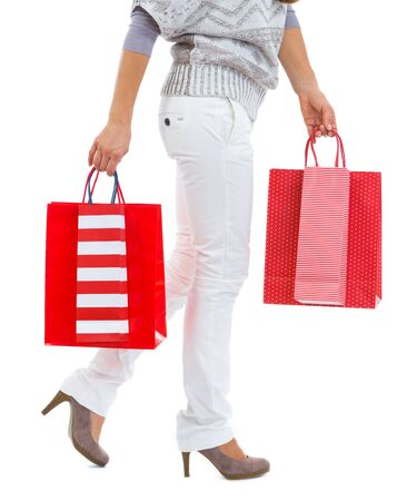 Closeup on woman walking with red shopping bags Stock Photo - 16336929