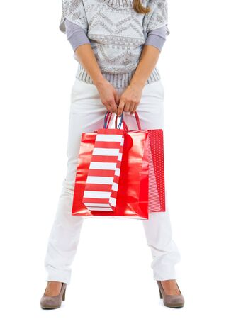 Closeup on woman standing with red shopping bags Stock Photo - 16336925