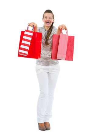 Happy woman in sweater with red shopping bags Stock Photo - 16336916