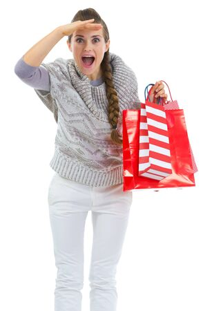 Woman in sweater with shopping bags looking into distance Stock Photo - 16336954