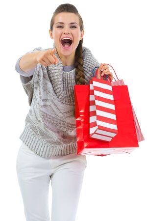 Woman in sweater with shopping bags pointing in camera Stock Photo - 16336943