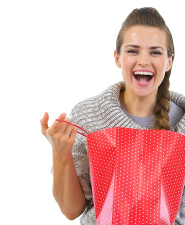 Smiling woman in sweater opening shopping bag Stock Photo - 16336966