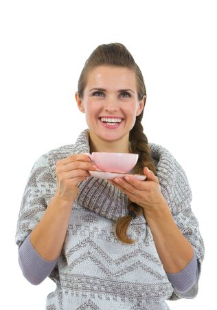 Happy woman in sweater having hot beverage Stock Photo - 16336976