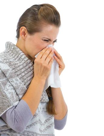 running nose: Woman having running nose and using napkin