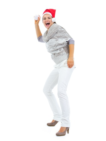 Cheerful woman in Santa hat throwing snowball Stock Photo - 16336913