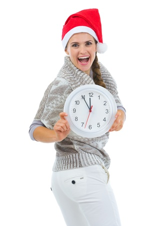 Happy woman in Santa hat showing clock Stock Photo - 16336920