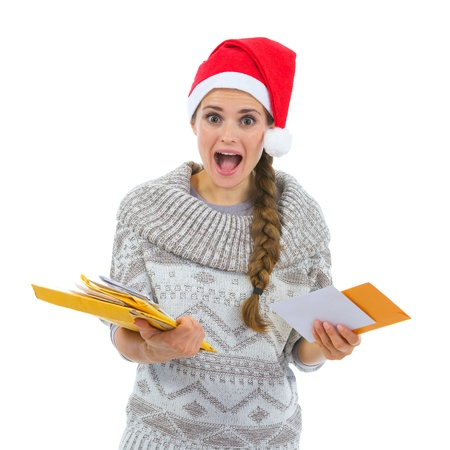 Shocked woman in Santa hat surprised by lots of Christmas letters Stock Photo - 16336941