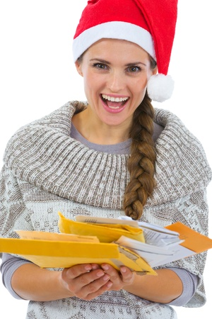 Happy woman in Santa hat holding pack of Christmas letters Stock Photo - 16336972