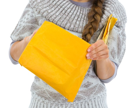 Closeup on woman opening letter Stock Photo - 16336956