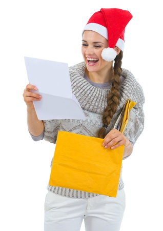Happy woman in Santa hat reading Christmas letter Stock Photo - 16336950