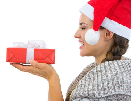 Happy woman holding Christmas present Stock Photo - 16336948