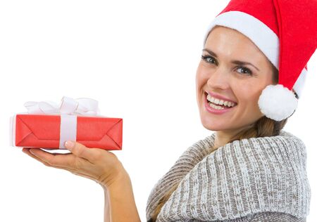 Smiling woman holding Christmas present Stock Photo - 16336968
