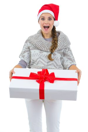 Surprised woman in Santa hat holding big Christmas present Stock Photo - 16336953
