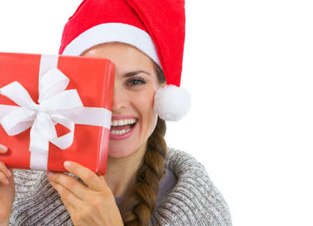 Smiling woman in Santa hat holding Christmas present Stock Photo - 16336944