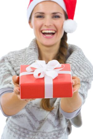 Smiling woman in Santa hat presenting Christmas gift box Stock Photo - 16336958