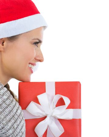 Smiling woman in Santa hat with Christmas gift box Stock Photo - 16336969