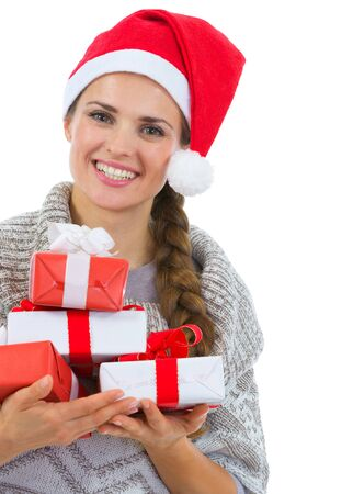 Smiling woman in Santa hat with Christmas gift boxes Stock Photo - 16336971