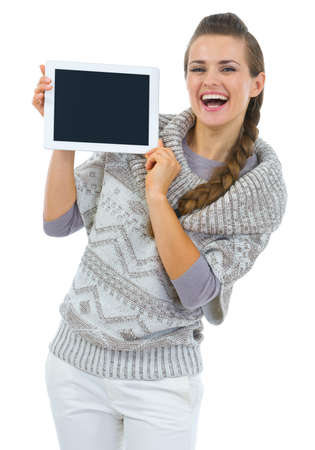 Happy woman in sweater showing tablet PC blank screen Stock Photo - 16336970