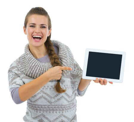 Smiling woman in sweater pointing on tablet PC blank screen Stock Photo - 16336949