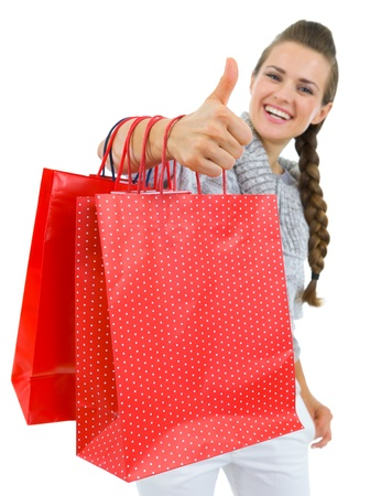 Closeup on showing thumbs up woman hand with shopping bags Stock Photo - 16336922