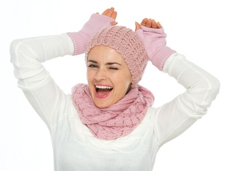 Portrait of playful young woman in knit scarf, hat and mittens Stock Photo - 16467309