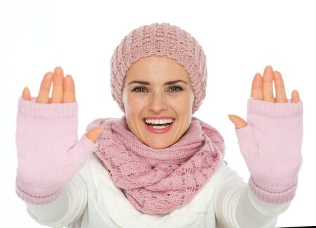 Happy young woman in knit winter clothes framing with hands Stock Photo - 16467282