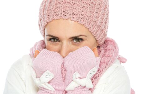 Happy woman in knit winter clothes breathing on hands Stock Photo - 16467270