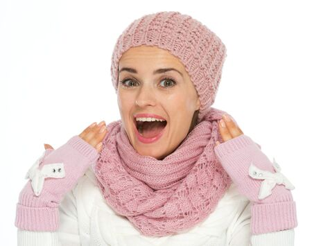 Surprised young woman in knit scarf, hat and mittens Stock Photo - 16467266