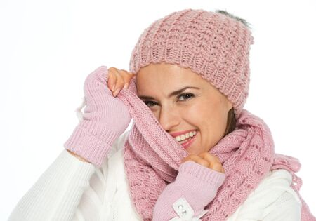Happy young woman hiding behind knit scarf Stock Photo - 16467247